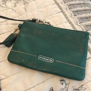 First green Coach wristlet